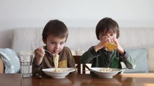 kids eating healthy noodles at home